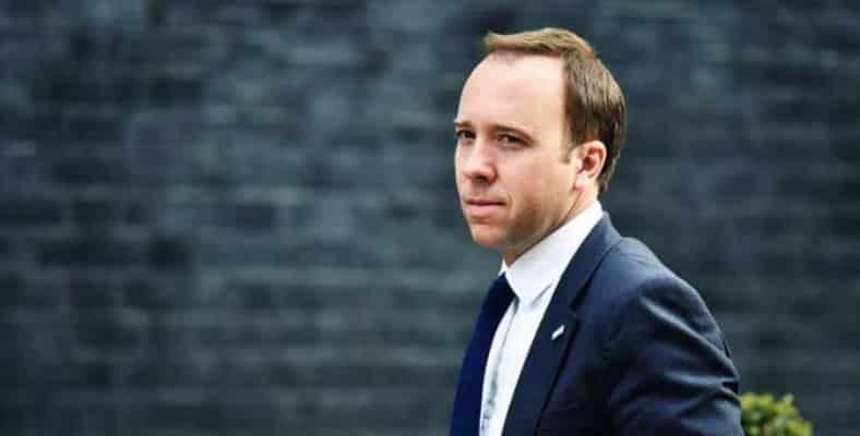 CONSULTANT KISSING UK HEALTH MINISTER
